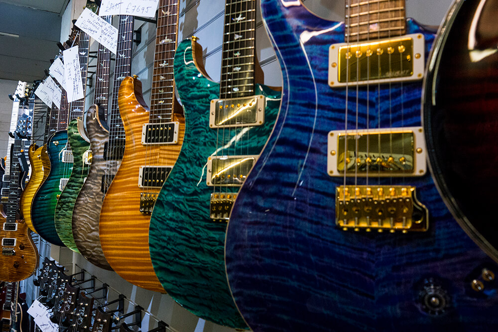 Delicious PRS Private Stock Guitar Wall (top row) and Our Own PRS USA Stock (bottom row)