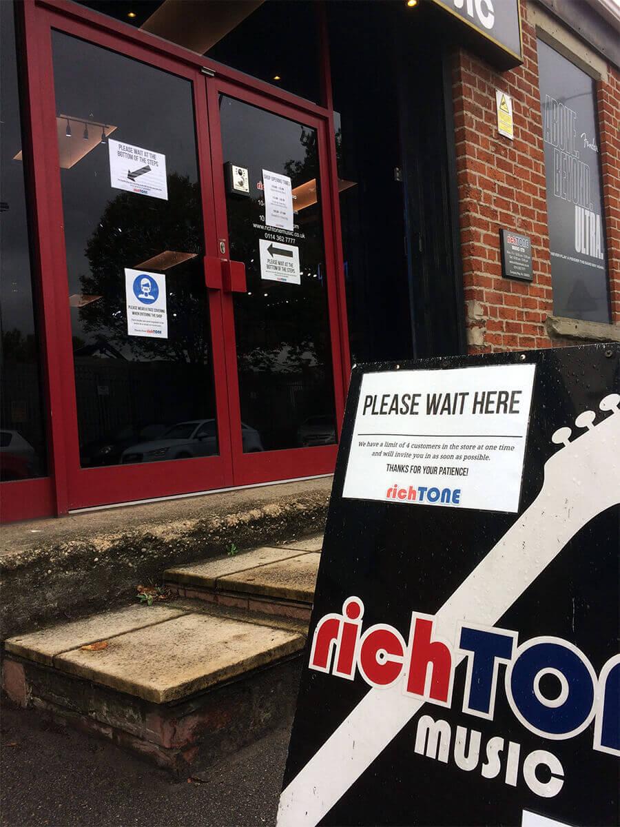 Please Wait Here Shop Sign